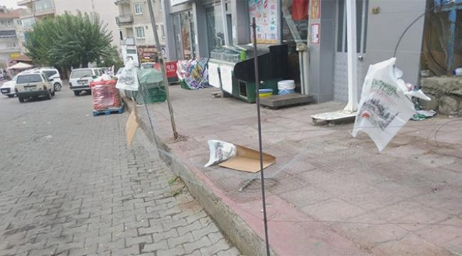 İş yeri sahibi marketin önünü tel örgü ile kapattı