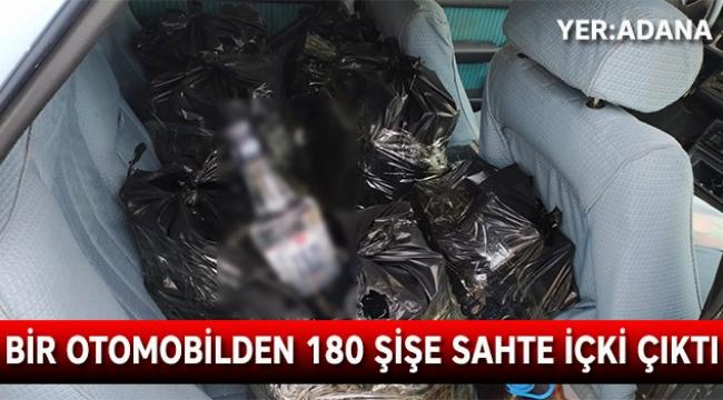 Bir otomobilden 180 şişe sahte içki çıktı
