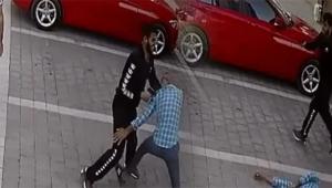 Kavga ettiği kapıcıyı silahla vurdu
