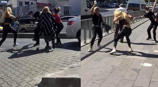 Dört kadın yol ortasında adamı dövdü