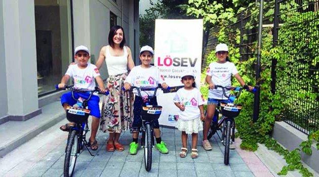 Lösemili çocukların  karne hediyesi bisiklet