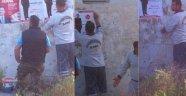 ASKİ ekipleri MHP'nin afişlerini asıyor